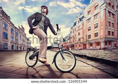 man on the vintage cycle - stock photo