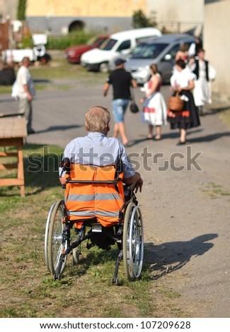 man on the wheelchair - stock photo