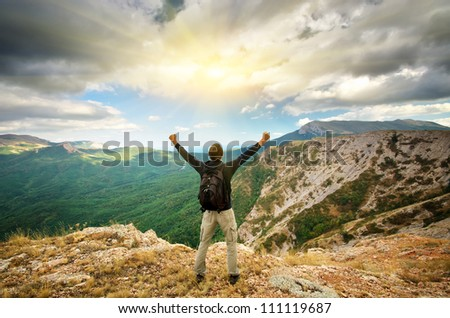 Man on top of mountain. Conceptual design.