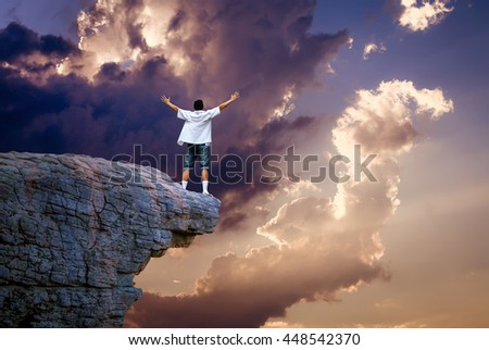 Man on top of mountain conceptual design of success freedom excitement