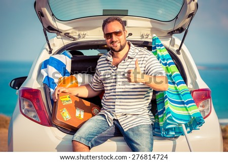 Man on vacation. Summer holiday and car travel concept - stock photo