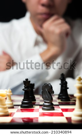 Man on white shirt playing chess think for strategy business concept - stock photo
