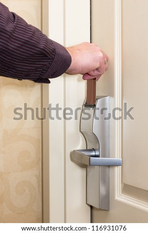 Man opening door with keyless entry card