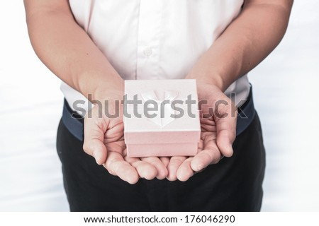 Man opening gift box - stock photo