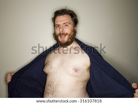 Man opening up his robe to reveal his naked body - stock photo