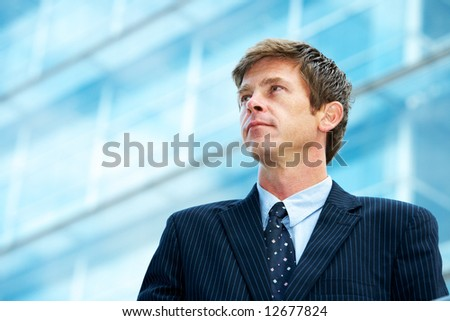 Man outside office building - stock photo