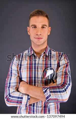 Man over dark background in squared shirt - stock photo