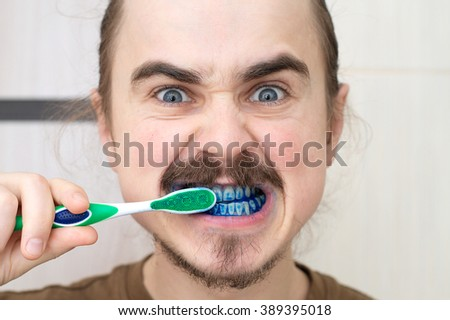 Man over whom played prank by coloring his tooth brush. April Fools! - stock photo