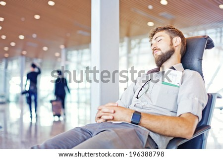 Man overslept his flight in airport - stock photo
