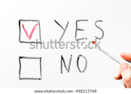 man painted tick marker selecting the answer is YES - stock photo