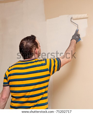 Man painting a wall - stock photo