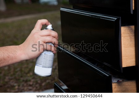 man painting cabinet drawer - stock photo