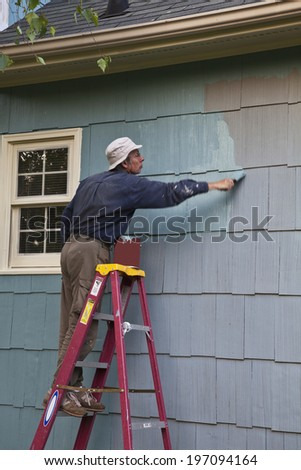 Man painting house - stock photo