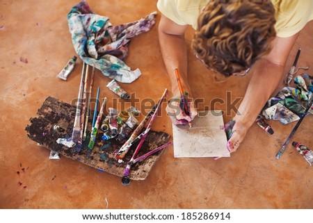 Man painting on the floor - stock photo