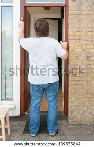 Man painting the door post - stock photo