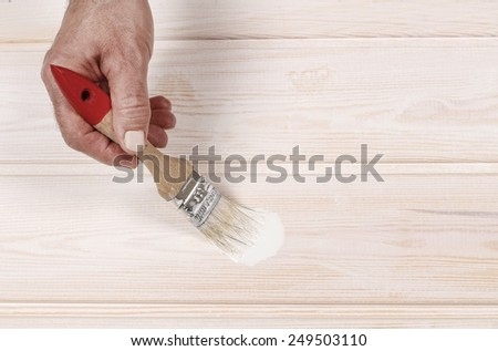 Man painting wood  - stock photo