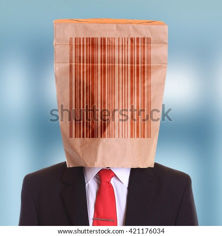 Man paper bag on head with barcode symbol  - stock photo