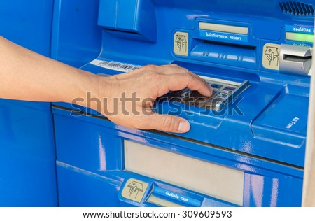 man pass ATM for Financial Transactions