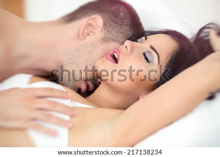 Man passionately engaged in sex with a beautiful girl - stock photo