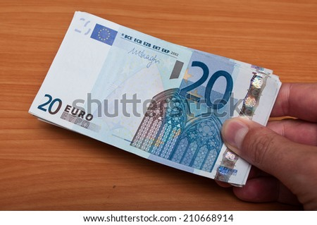 man pay with banknote of twenty euros