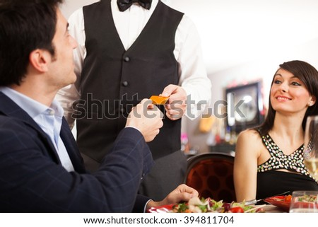 Man paying dinner in a restaurant - stock photo