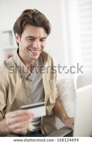 man paying online ordering - stock photo