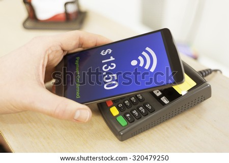 Man paying with NFC technology on mobile phone, Dollar version - stock photo