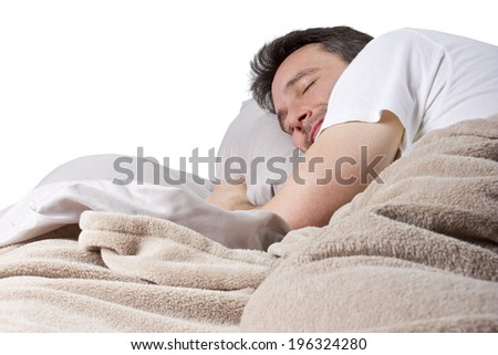man peacefully sleeping in a quiet bedroom  - stock photo