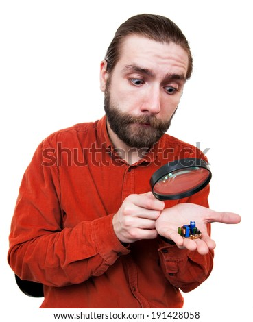 Man Peering through Magnifying Glass - stock photo
