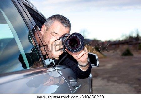 Man photographed from the car - stock photo