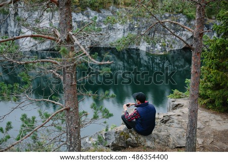 man photographing beautiful view from the cliff