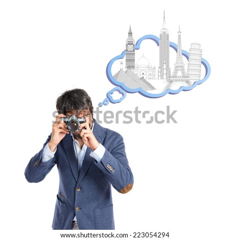 Man photographing over white background - stock photo