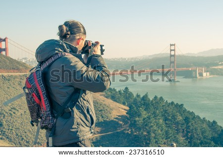 Man photographing San Francisco cityscape from Twin Peaks - stock photo