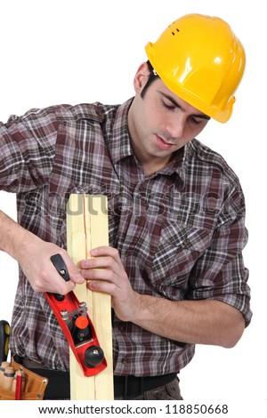 Man planing wood - stock photo