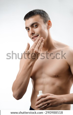 man plaster skin aftershave - stock photo
