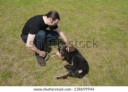 Man played with his dog on field