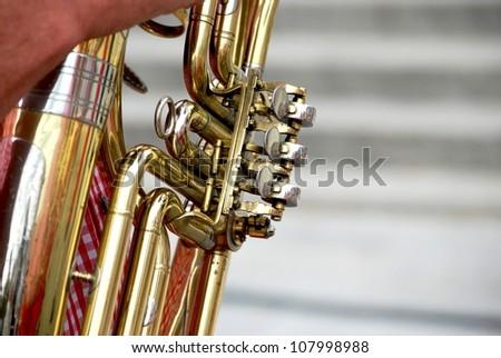 Man playing a tuba - stock photo
