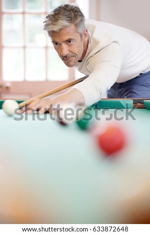 Man playing american pool