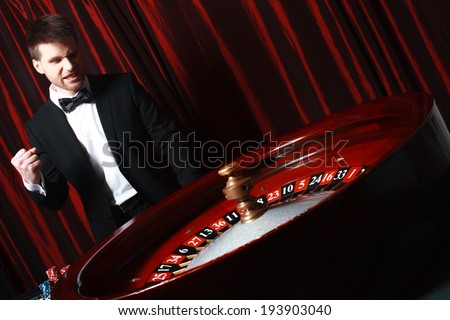 man playing at the casino. studio shot - stock photo
