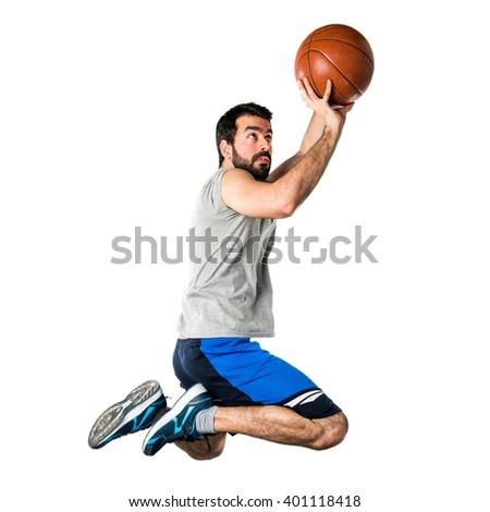 Man playing basketball jumping