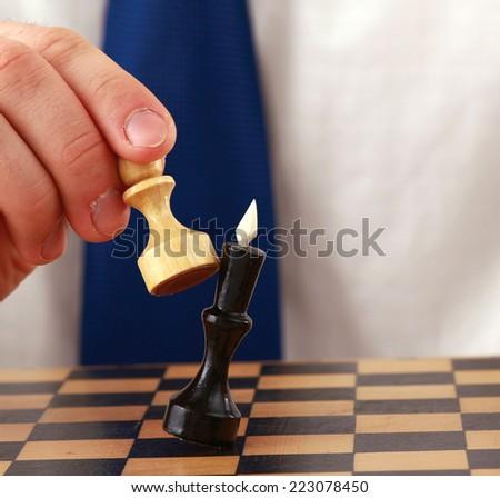 Man playing chess - stock photo