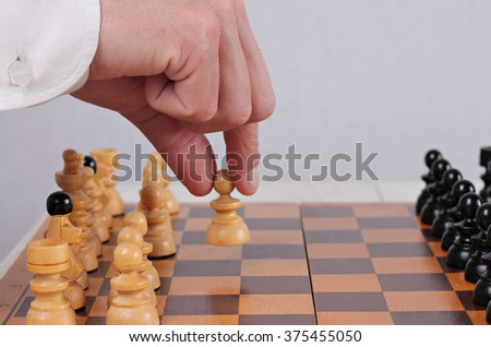 Man playing chess close up. First step, business strategy, success    concept  - stock photo
