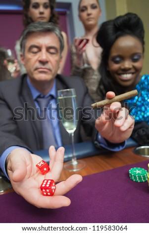 Man playing craps in casino - stock photo