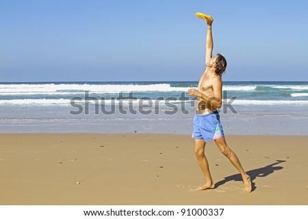 Man playing frisbee - stock photo