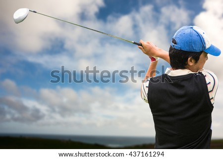Man playing golf against blue sky with white clouds