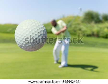 Man playing golf at club