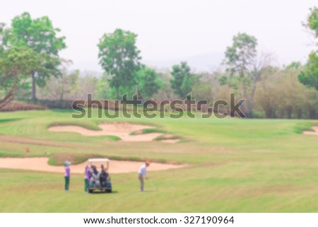 Man Playing Golf  Green Golf Course. Blur for background - stock photo