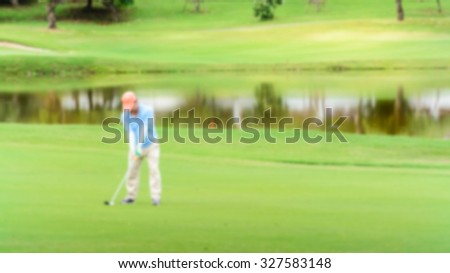 Man Playing Golf  Green Golf Course. Blur for background. - stock photo