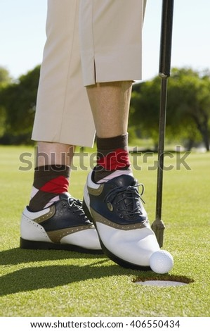 Man playing golf in summer day