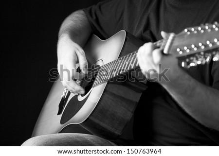 Man playing guitar - stock photo